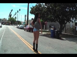 Girl goes for a walk in bikini and boots