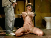 Safira White is a fair haired naked slave girl with
