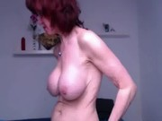 Granny fingering herself standing up