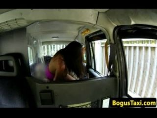 Busty amateur in cab cocksucking