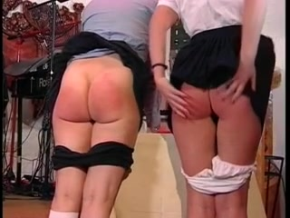 2 asses getting spanked