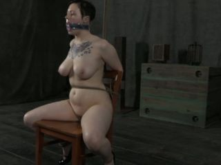 Juggy chick with sexy tattoo is punished while siting on the chair