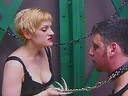 Dominant blonde with slave on a leash