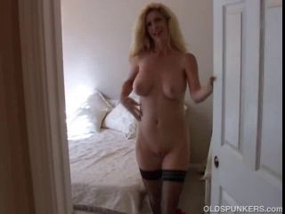 Blond mother I\'d like to fuck in nylons shows off her enchanting large boobs and