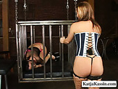 Curvy red-haired MILF drills fresh cunt of frisky amateur with dildo through cage grids