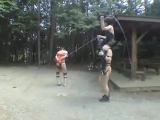Plays with slaves outdoors