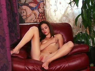 Creamy skinned brunette Kiera Winters lays back in a familiar red chair, spreads her long legs and fingers her inviting pussy for a sweet release.