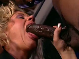 Horny black dude fucks alluring blonde stripper on the stage
