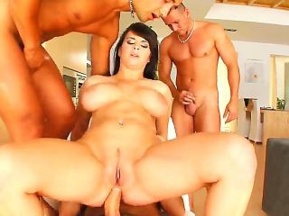Busty babe named Kristi gets surrounded with cocks and she has to take care of them all