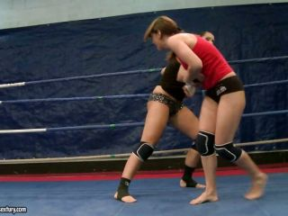 Eliska Cross and Lisa Sparkle fight in the ring